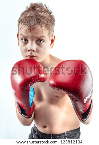 Cute boy in the boxing gloves, isolated on white - stock photo