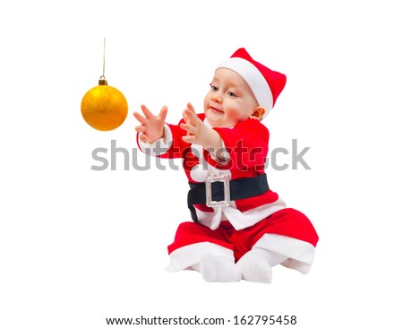 Cute boy in the costume of Santa Claus with the decoration for the Christmas tree isolated on white background - stock photo