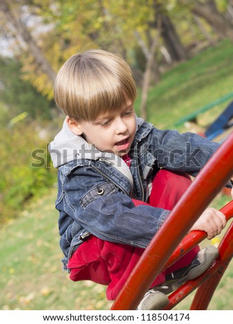cute boy in the park - stock photo