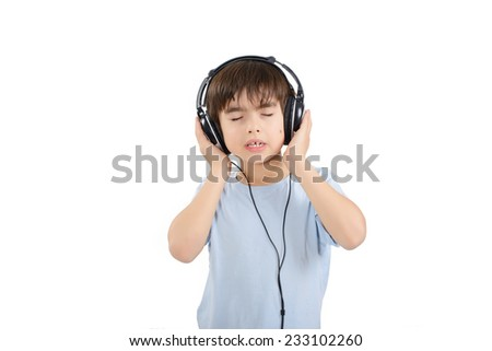 Cute boy is listening to music with eyes closed - stock photo