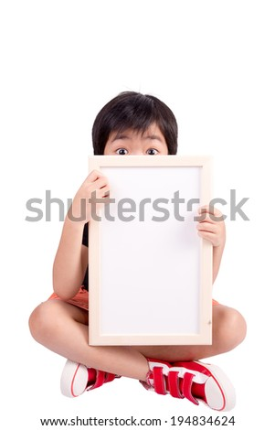 cute boy is looking out from the blank banner, isolated over white - stock photo