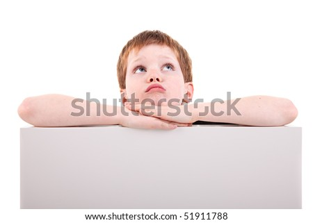 cute  boy looking up with white board,  isolated on white background. Studio shot