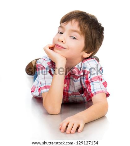 cute boy lying on white floor - stock photo