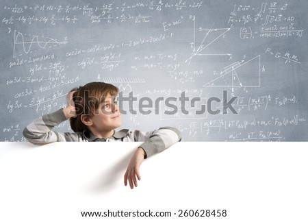 Cute boy of school age with blank advertising board - stock photo