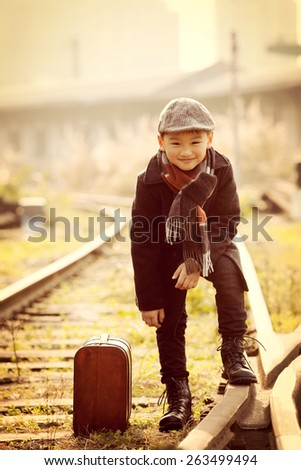 cute boy on a railway station - stock photo