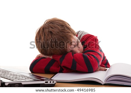 cute boy on the desk asleep while studying - stock photo