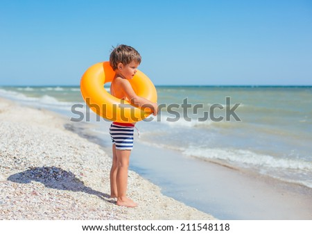 cute boy on the summer beach - stock photo