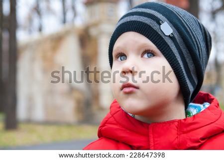 Cute boy outdoors in autumn - stock photo