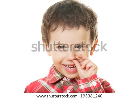 Cute boy picking nose on isolated white - stock photo