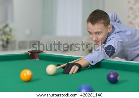 cute boy playing billiard - stock photo