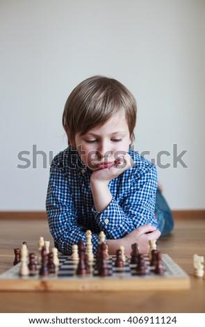 cute boy playing chess  cute boy playing chess - stock photo
