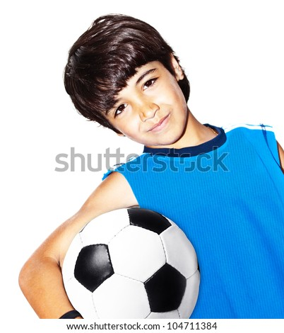 Cute boy playing football, happy child, young male teen goalkeeper enjoying sport game, holding ball, isolated portrait of a healthy preteen having fun, kids activities, little footballer - stock photo