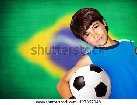 Cute boy playing football, happy child, young male teen goalkeeper enjoying sport game, holding ball, portrait of a healthy preteen having fun, kids activities, little footballer - stock photo
