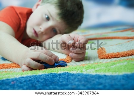 Cute boy playing in his room - stock photo