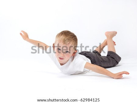 cute boy playing on white background - stock photo