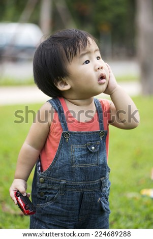 Cute boy plays in the park - stock photo
