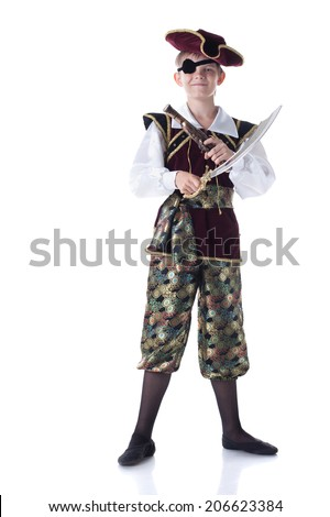 Cute boy posing in pirate costume with eye patch - stock photo