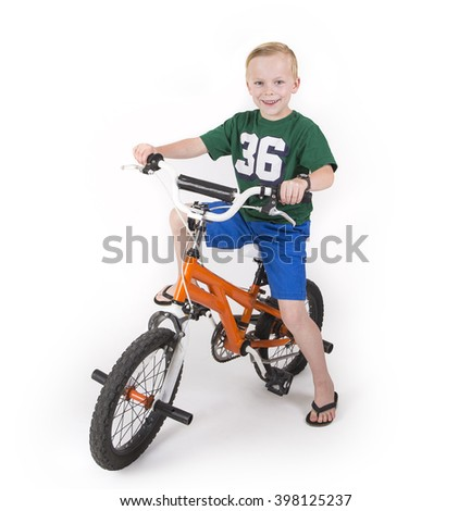 Cute boy riding his bike isolated on white background