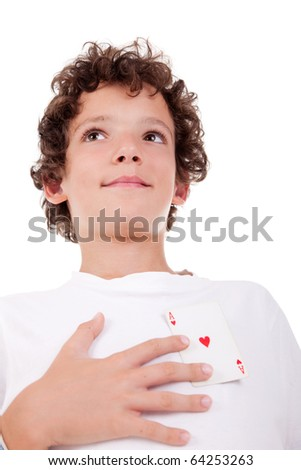 cute boy showing an ace of hearts, in place of the heart, isolated on white, studio shot - stock photo