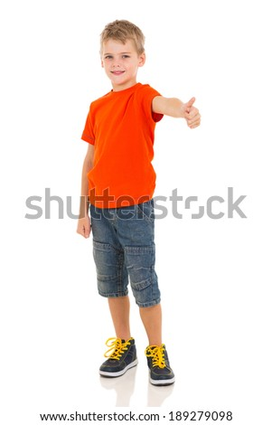 cute boy showing thumb up gesture on white background - stock photo