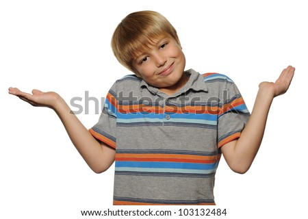 Cute Boy Shrugging on White Background. Elementary school age boy shrugging while smiling on a white background. - stock photo