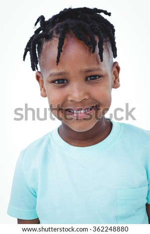 Cute boy smiling at the camera on white screen