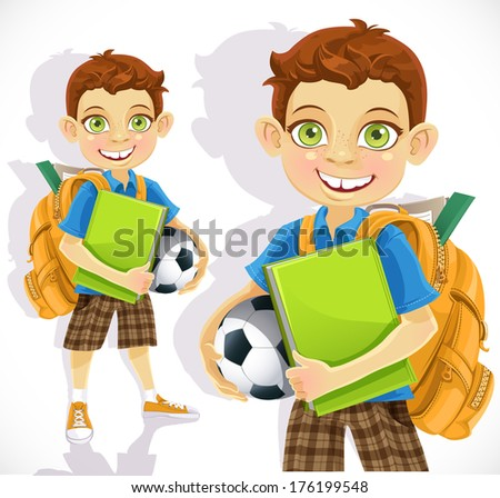 Cute boy student with a backpack and a textbook - stock photo
