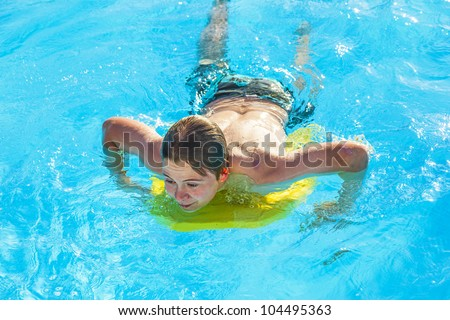 cute boy surfing in the pool