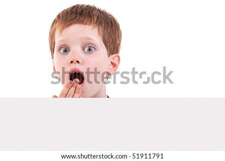 cute  boy surprised with white board,  isolated on white background. Studio shot - stock photo