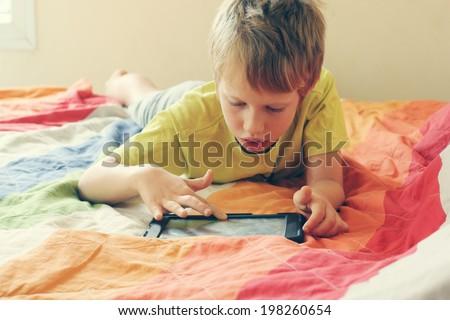 Cute boy using a laptop - stock photo