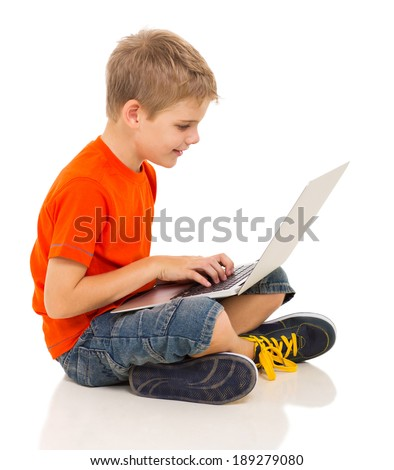 cute boy using laptop computer isolated on white background - stock photo
