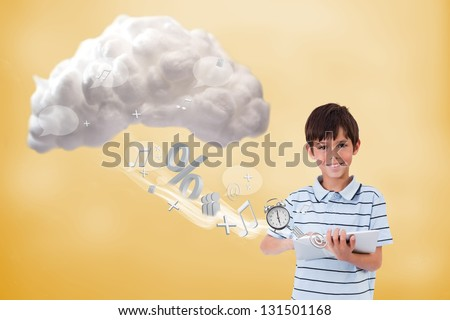 Cute boy using tablet to connect to cloud computing on yellow background - stock photo