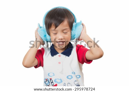 Cute boy wearing headphones and enjoying music,Isolated - stock photo