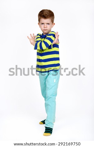 Cute boy with a angry expression on white background - stock photo