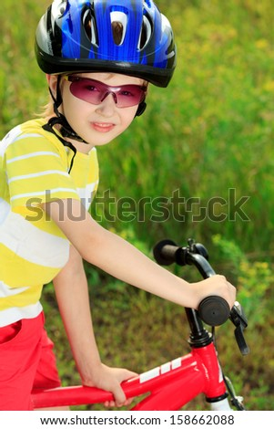 Cute boy with a bicycle outdoors. - stock photo