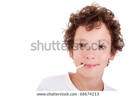 Cute Boy with a candy on mouth smiling, isolated on white, studio shot