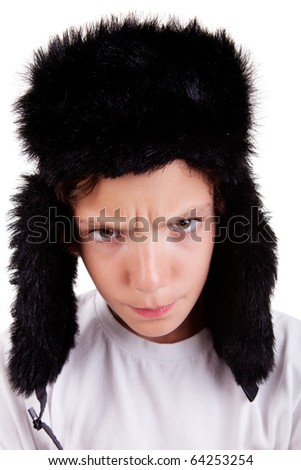 cute boy with a cap, angry, isolated on white background, studio shot. - stock photo