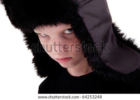 cute boy with a cap, bored,  isolated on white background, studio shot.