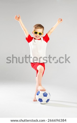 Cute boy with a football ball - stock photo