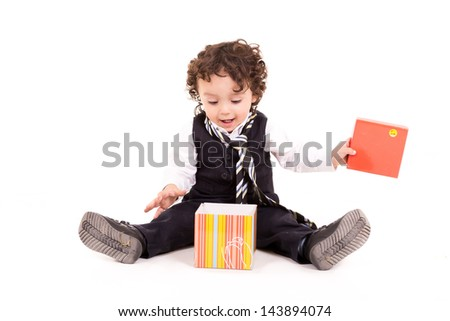 cute boy with a present - stock photo