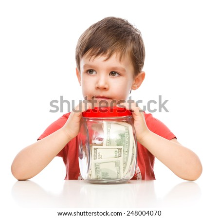 Cute boy with dollars, isolated over white - stock photo