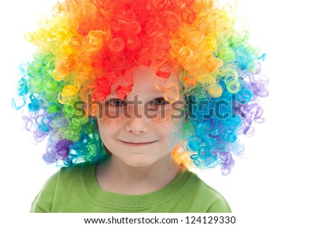 Cute boy with freckles and clown hair - closeup - stock photo