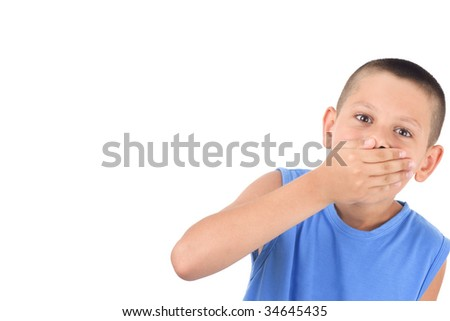cute boy  with  hands covering  mouth as if in surprise - stock photo