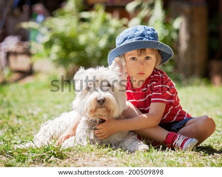 Cute boy with his dog friend - stock photo