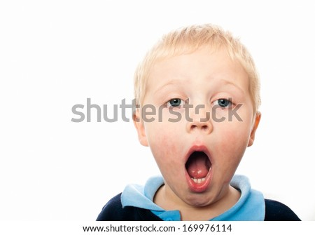 Cute boy with mouth wide open - stock photo