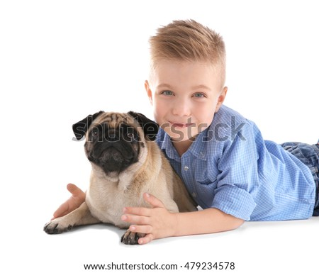 Cute boy with pug dog on white background