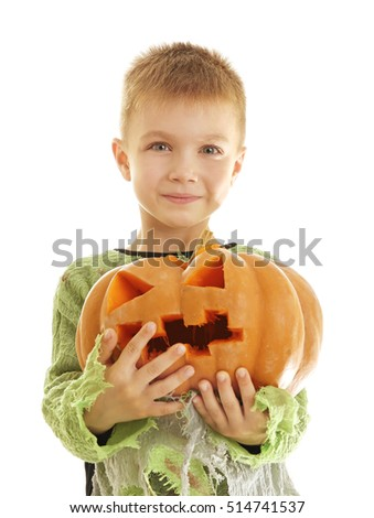 Cute boy with pumpkin in Halloween costume on light background