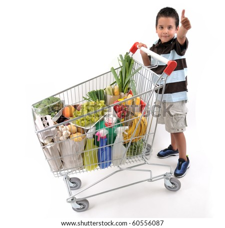 Cute boy with shopping trolley isolated on white - a series of SHOPPING TROLLEY images. - stock photo