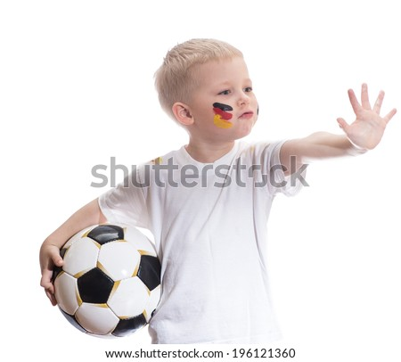 Cute boy with soccer ball and germany flag on his cheeks