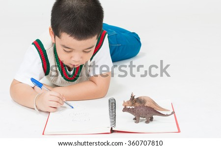 Cute boys do their homework on a white background.